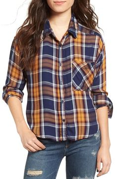Bold plaid and a patch pocket add rustic touches to this soft, feminine cut.