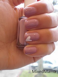 Nude nails with little white heart...so cutes.