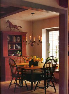 Prim Dining...my colonal red, its all over my home, even my front door is painted this red!
