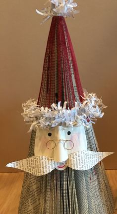 """These stacked BOOK PAGE SANTAS made from fanned book pages are great for stand alone, centerpieces, shelves, and GIFTS. Ships and stores flat for protection and convenience. SANTAS are stacked separate sections. Can be """"fluffed"""" by pinching together open sections at the center and or,"""