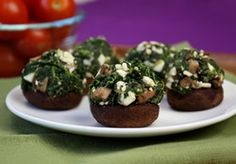 Super-Stuffed Spinach-Feta Mushrooms HungryGirl.  12 medium baby bella mushrooms (each about 2 inches wide), stems chopped and reserved One 10-oz. package frozen chopped spinach, thawed and squeezed dry 1/2 cup crumbled reduced-fat feta cheese 1/2 tsp. garlic powder 1/2 tsp. onion powder  1/4 tsp. each salt and black pepper