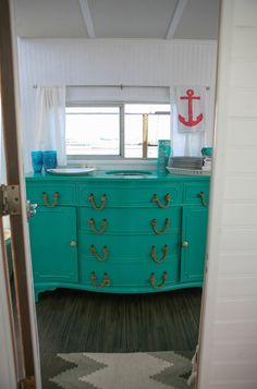 House of Turquoise: Belafonte Houseboat Love this dresser!! look at the rope pulls!