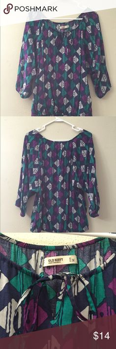 Multicolored Top Multicolored top.  Light elastic at the hem and sleeves.  Ties at the neck like peasant tops and is flowy through the midsection.  3rd pictures shows the beautiful colors.  Size medium.  No flaws. Tops Blouses