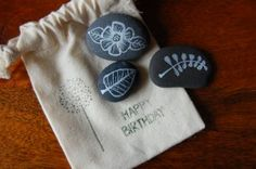 white ink painting on smooth stones as hostess gifts or small bday treasures