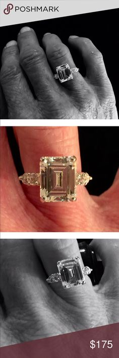 Emerald cut CZ ring 4 carat Superior quality CZ ring with 2 round CZ side stones. Show stopper. Like new. Jewelry Rings