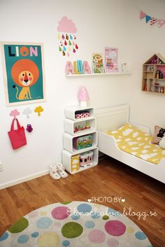 pink with yellow girl room - nice storage idea next to the bed