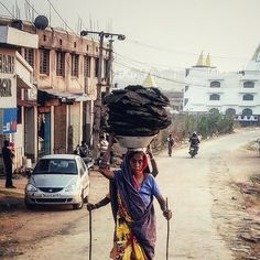 Two Indian woman carry cow dung in metal containers on top of their heads in Ranchi. Jharkhand India.  #everydayeverywhere #Dailylife #photojournalism #journalism #reportage #reportagespotlight #hufgpostgram #indiaphotoproject #outofthephone #onepluslife #oneplus2 #myfeatureshoot #Instagram #Ranchi #Jharkhand #India #Asia by arjunchhabra