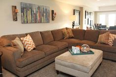 Turquoise, orange and brown make a lovely melody of hues on this large sectional.