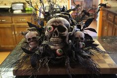 Just to throw in another idea, other than the cemetery centerpiece...You could do something like this. If you were going with a pirate theme, you could put a pirate kerchief around the skull or put an eye patch on it