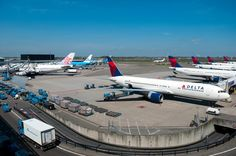 A typical Amsterdam Schiphol Airport view. Taken from the panorama terrace. Delta B767.