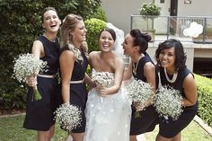 Love the dark dresses with baby's breath bouquet. Great bridesmaids' bouquet size.