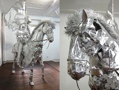 When I look at the incredible work of artist Toshihiko Mitsuya I can't help but be reminded of that kid with no money who made action figures out of twist ties. Mitsuya's sculptures are created out of aluminum foil, not twist ties, but there's the same sense of child-like wonder in his work.