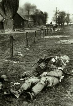 17th Airborne Division medic working on a wounded comrade during the fighting around Wesel, Germany on the first day of Operation Varsity, March 24, 1945.