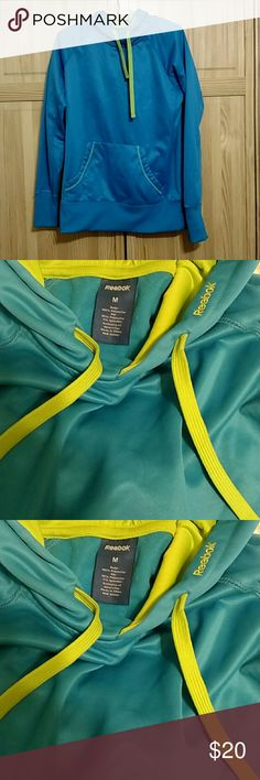 Reebok blue hoodie sweatshirt Hoodie is in great condition and was barely worn. Material is silky on the outside but fuzzy soft on the inside. Fits more like a small. Reebok Sweaters