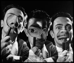 Salvador Dali with magnifying glass, 1946 by Philippe Halsman.