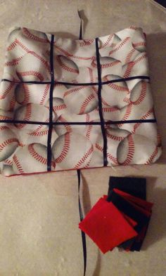Check out this item in my Etsy shop https://www.etsy.com/listing/267530660/baseball-felt-and-fabric-tic-tac-toe