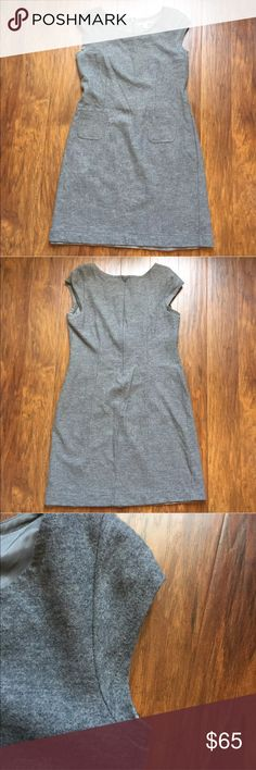 """Banana Republic Gray Wool Sheath Dress Size 16 This dress is in beautiful condition! Looks new! While it may be 100% Wool, the material doesn't feel too thick or hot. There is a polyester lining attached. Zips in the back. Size 16. 🚫 trades    Armpit to armpit: ~19.5""""  Waist: ~18""""  Length: ~36"""" Banana Republic Dresses Midi"""