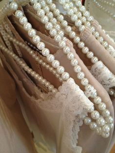 Blush and lace on pearl hangers.