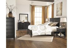 "The Owingsville Panel Bedroom Set from Ashley Furniture HomeStore (AFHS.com). The ""Owingsville"" bedroom collection features a rustic black painted finish beautifully covering the thick moulding details and bevel drawer front design supported by stylish turned feet to create an inviting casual design that is sure to enhance the beauty and atmosphere of any bedroom décor."