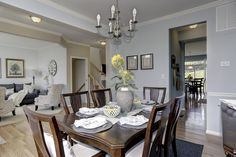 New Homes & Townhomes on the East Coast Light Blue Walls, Home Decor Lights, New Home Builders, White Curtains, Floral Wall, Model Homes, Dining Area, Townhouse, House Plans