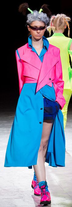 Love the angles in the short jacket, the weird antennae, not so much. Yohji Yamamoto - S 14