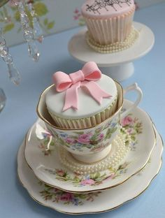 Pretty little cupcake with a bow on top in a tea cup!