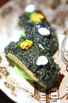 One of the best dishes at Rose. Rabbit. Lie. is the Caviar Tacos served in a Yukon Gold potato shell with Hamachi.