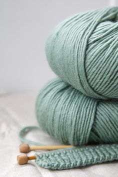 love the color of this yarn! Makes me want to learn how to knit :)