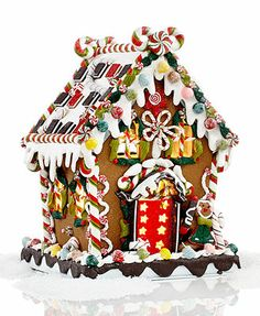"Kurt Adler Christmas Decoration, 8"" Pre-Lit Gingerbread House.  $72"