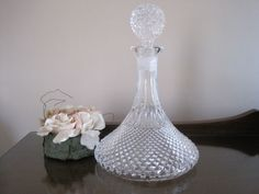 Here is a beautifully patterned heavy cut glass ships decanter.  It has a very wide base with a lovely design on the base ans a heavy ball shaped solid glass stopper.  It stands 29 cms tall and measures 19 cms across the base.  It is in excellent condition with no chips to the stopper or the opening.