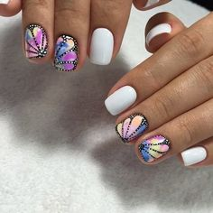 The Spring White Nail Art. Spring is just about to arrive and you can enjoy this season with some preparation on your nails. This butterfly wing is the perfect welcome for the spring season.