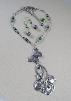 Spring Challange Set, Mostly B'Sue pieces, featuring chain, clasp, jumps, butterfly, rhinestones and filigree balls. Everything else from my stash.