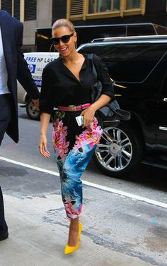 Beyonce spotted earlier today in New York City rocking yellow pumps and print slouchy pants