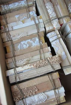 stacks of old books wrapped with twine and lace for decorations