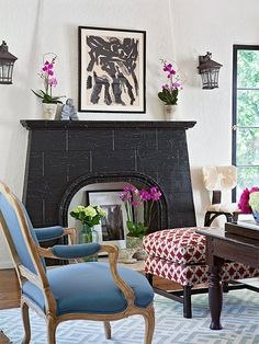 A limestone fireplace was dramatically transformed with black paint and became the focal point of this living room!  http://www.bhg.com/decorating/decorating-photos/living-room/amp-up-a-fireplace/?socsrc=bhgpin022815ampupafireplace&living-room