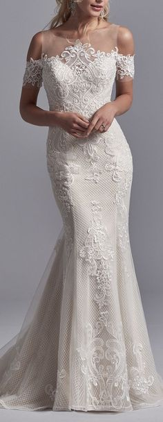 Sottero and Midgley - ELIN, Lace motifs cascade over tulle and netting in this unique wedding dress, accenting the exquisite illusion neckline, cold shoulder sleeves, and illusion scoop back. Finished with covered buttons over zipper closure.