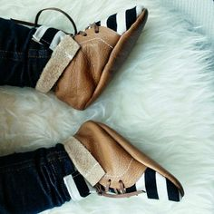 Little Yeti shoes are lovingly handmade using real leather. The shoes have soft soles, which are gentle on baby's feet and perfect to toddle