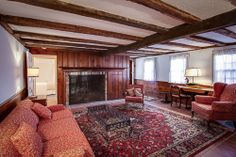 Original wood beams and one of four working fireplaces.