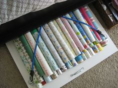 Wrapping paper storage idea that slides under the bed!
