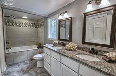 Traditional Master Bathroom with limestone tile floors, Rain shower, Cambria Quartz - Brentwood, specialty door, Flush