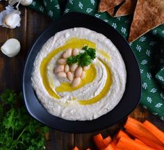 A recipe for Roasted Garlic White Bean Hummus, starring Great Northern Beans and Roasted Garlic. This 5 ingredient recipe with quickly become your go to hummus recipe and favorite snack! New Recipes, Vegan Recipes, White Bean Hummus, Great Northern Beans, 5 Ingredient Recipes, Hummus Recipe, White Beans, Roasted Garlic, Snacks