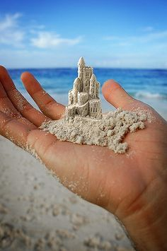 Miniature Sand Castle on the palm