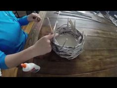 Video tutorial on how to make a DIY basket made out of newspaper.  These baskets make really cute home decor and can also be functional! Easy project for the kids to try too!