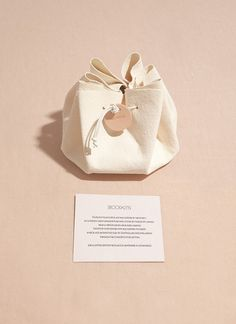 .Hmm... cut a circle out of felt or a fabric that won't unravel, like fleece. Use a heavy needle and string or perle coton run thread around the perimeter. Voila - a drawstring pouch!