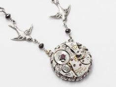 Steampunk Necklace Steampunk Jewelry vintage watch movement gears silver filigree purple & black Swarovski crystal bird pendant Gift 1932. $59.00, via Etsy.