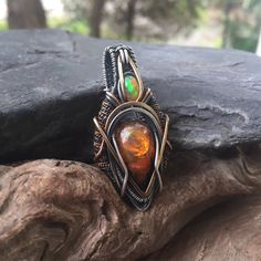 A personal favorite from my Etsy shop https://www.etsy.com/listing/470595986/opal-wire-wrap-wire-wrapped-pendant