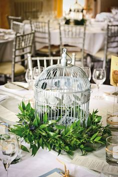 Birdcage centerpiece, silver chiavari chairs - Classic English-countryside Wedding Ideas (BridesMagazine.co.uk)