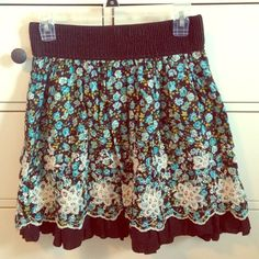 Brown Skirt with Blue & White Floral Pattern Beautiful Brown Joe Benbasset skirt with Blue and white floral pattern, and white embroidered flowers. Has stretchy elastic waist that makes it fit a small to a medium! In great condition (: NO trades NO PayPal Joe Benbasset Skirts Circle & Skater