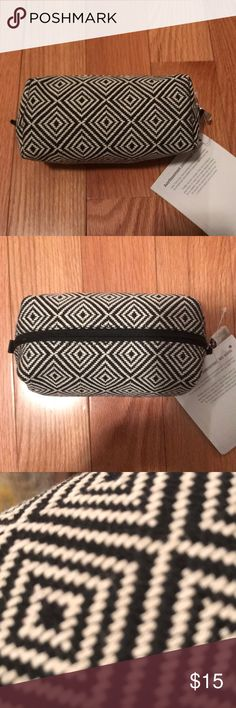 "Thirty One Uptown mini pouch NWT Thirty One uptown mini pouch.  Black and white woven cloth-like fabric. Perfect for makeup or odds and ends in your purse or travel bag! Approx 6 1/2"" x 3""x 3 1/2@ thirty-one Bags"