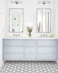 light blue bathroom vanity, tile above vanity, double mirrors, light and neutral bathroom. Our WaterworksStudio collection of streamlined essential 301459768807142530 Blue Bathroom Vanity, Bathroom Vanities, Neutral Bathroom, Blue Bathrooms, White Bathroom, Parisian Bathroom, Bathroom Vanity Lighting, Bathroom Cabinets, Sinks
